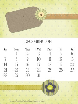 2014 calendar in shades of green with a paper tag, ribbons and flowers